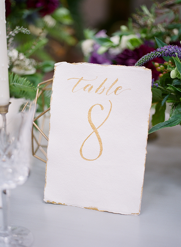 rustic table numbers - photo by Jillian Rose Photography http://ruffledblog.com/romantic-wedding-ideas-with-pops-of-jewel-tones