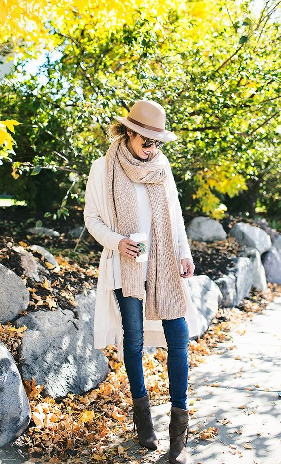 a neutral look with a white cardigan and a nude scarf