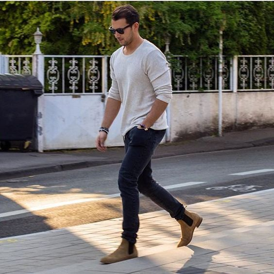 navy jeans, a white long-sleeve and ocher boots