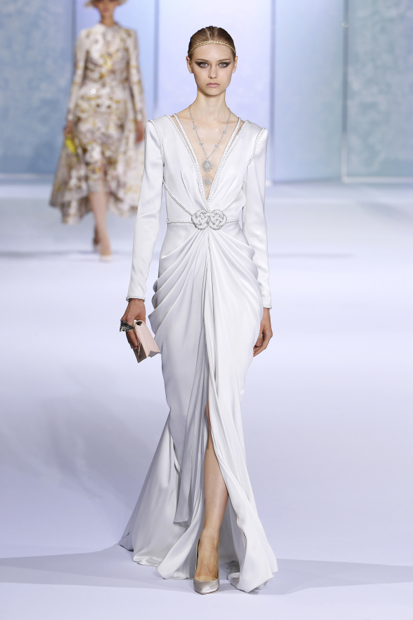 Ralph&Russo minimalist wedding dress with a plunging neckline and delicate detailing
