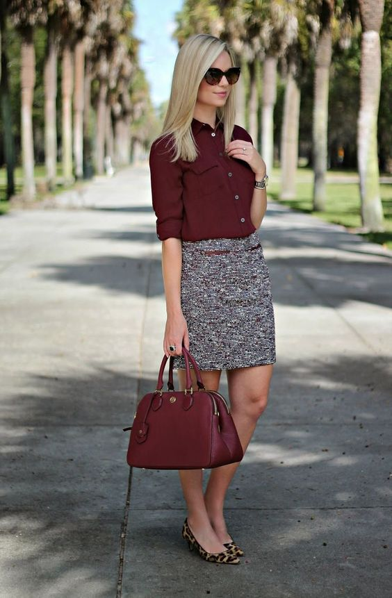 neutral-printed skirt, a burgundy blouse and bag, leopard flats