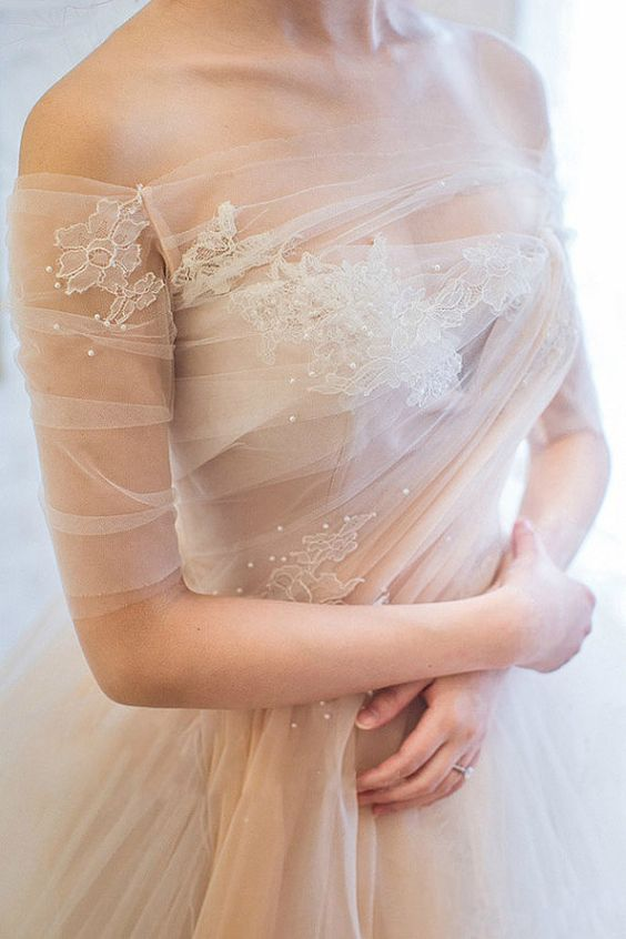 off the shoulder peach tulle wedding gown