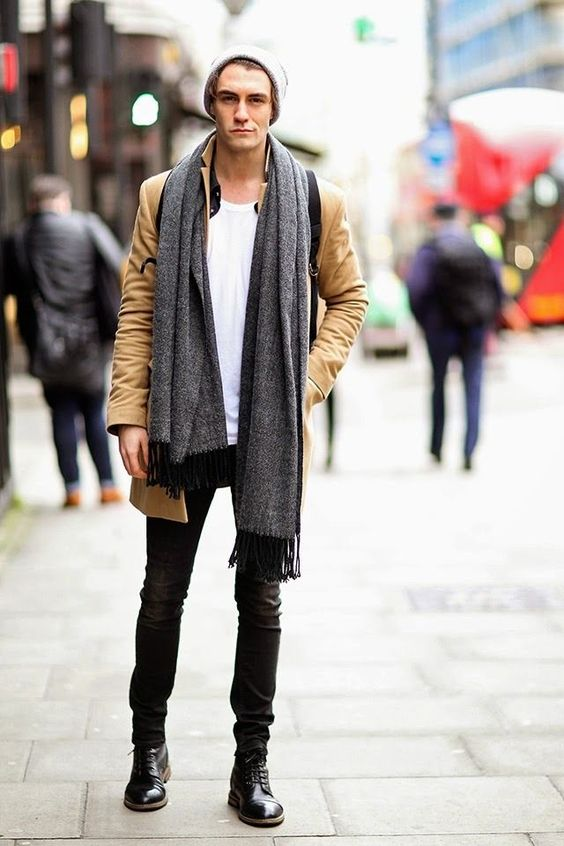 black jeans, a white tee, an ocher moto jacket and black boots