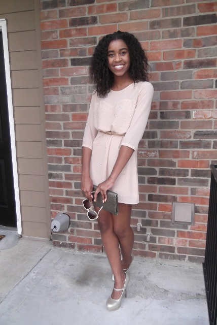 With silver shoes and cute clutch