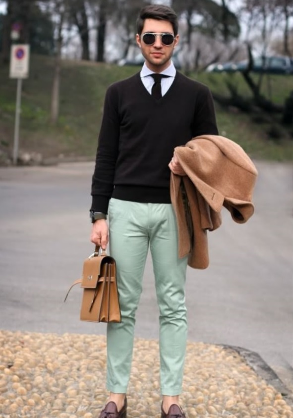 mint trousers, a black sweater and tie, a camel coat