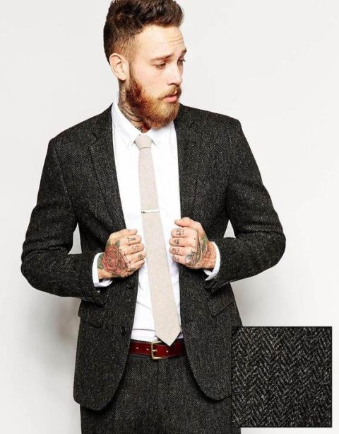 With beige tie, white shirt and tweed pants