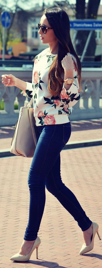 blue skinnies, a floral print sweatshirt and nude shoes