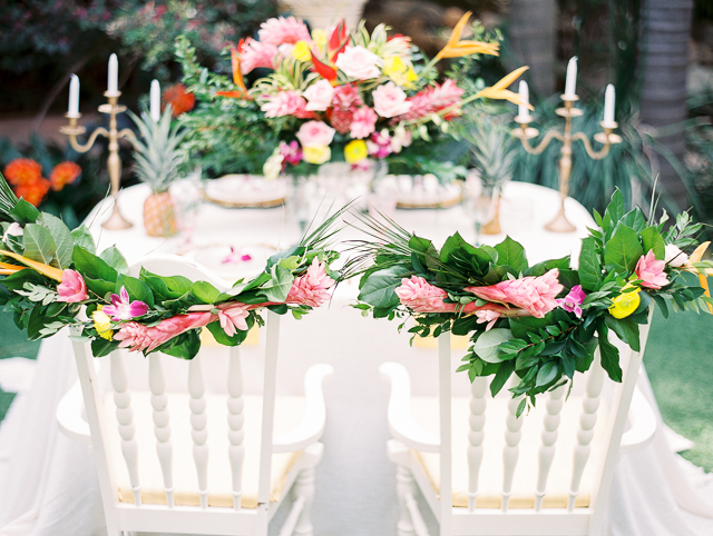Tropical flower chair leis | Angelica Chang Photography