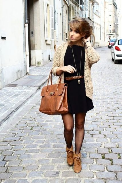 With black dress, neutral jacket and leather bag