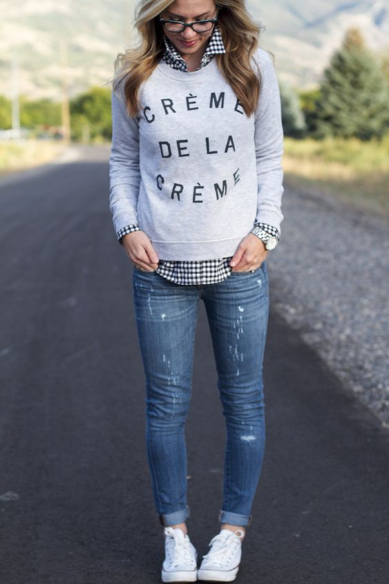a graphic sweatshirt, a checked shirt and blue denim
