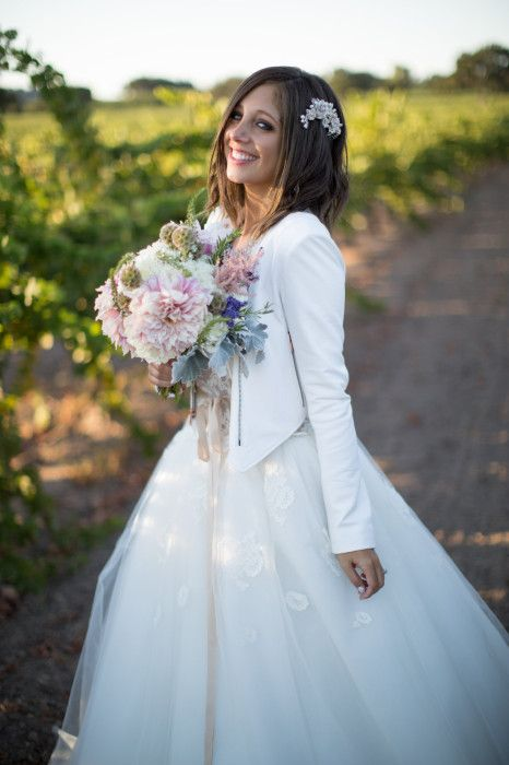 wedding ball gown with a cropped white leather jacket