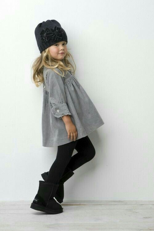 black leggings, a grey dress and black boots with a knit hat