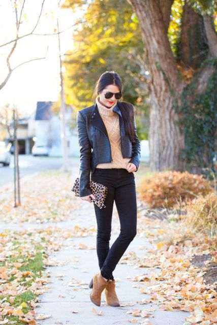 With dark gray jacket, black pants and leopard clutch