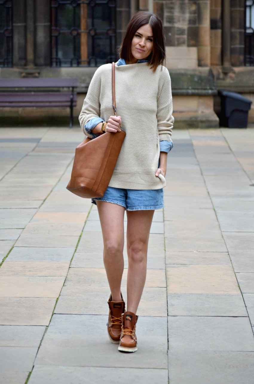 denim romper, a neutral oversized sweater and boots