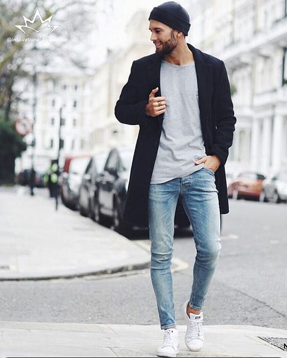 blue skinnies, a grey t-shirt, a black coat and white sneakers