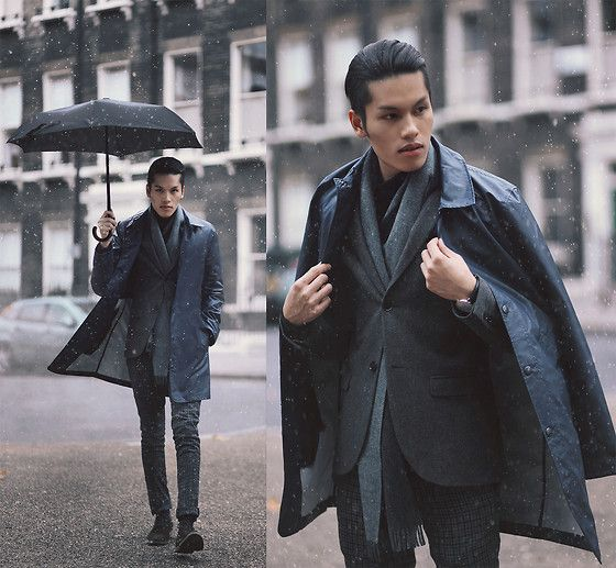 grey pants and a jacket, a leather coat and boots