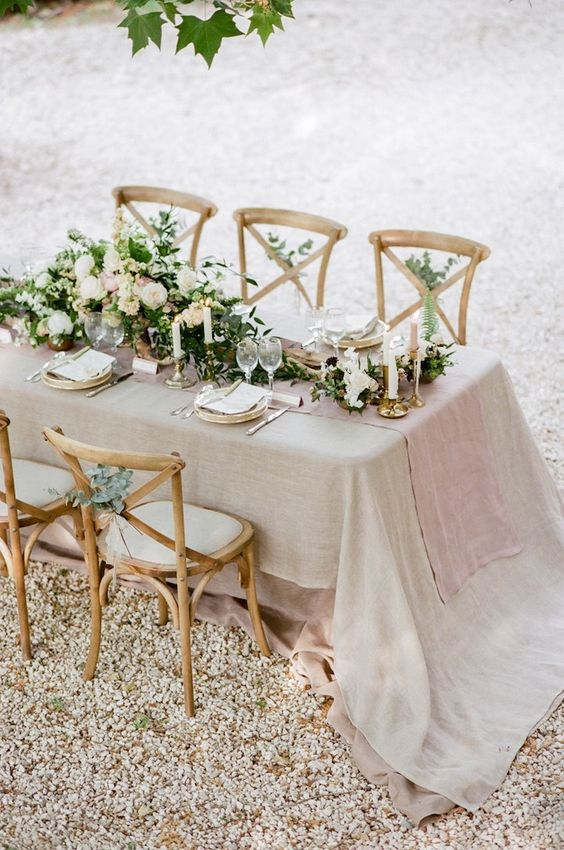 soft neutral table setting with greenery