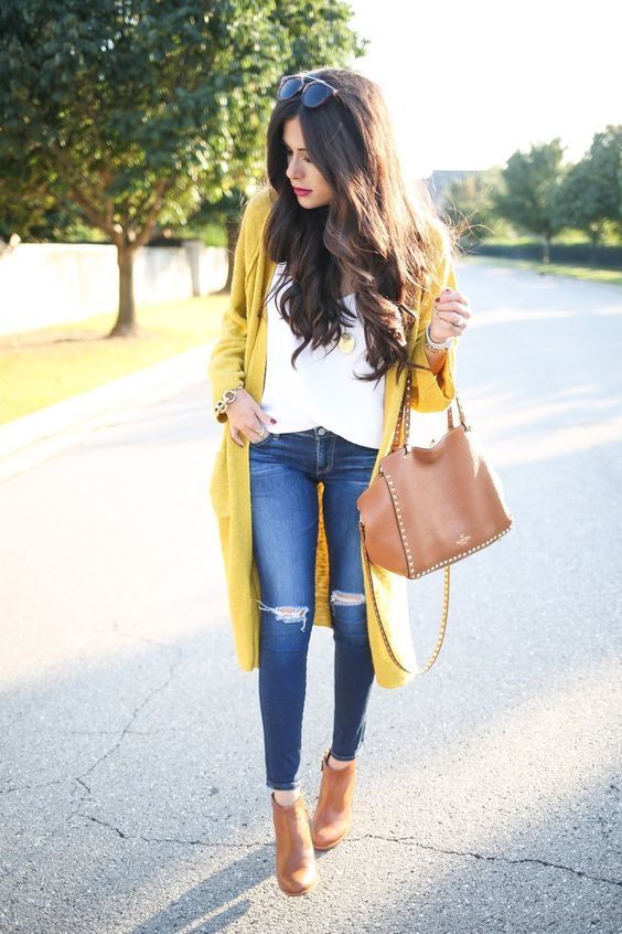 long mustrad cardigan, ripped jeans, a white blouse and brown ankle boots