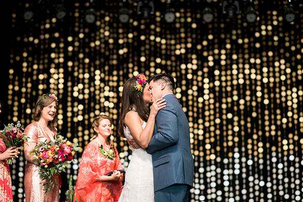 wedding kiss - photo by A.J. Dunlap Photography http://ruffledblog.com/brightly-colorful-sequined-wedding
