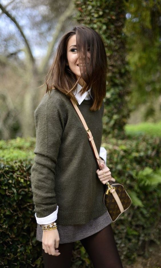 green sweater, a white button down, a mini tweed skirt