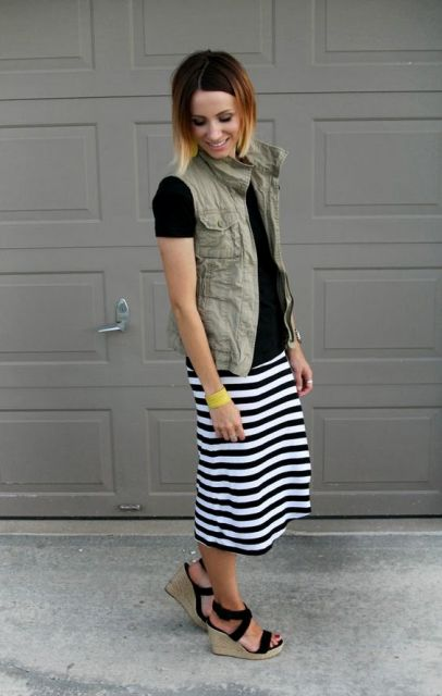 WIth black shirt and striped skirt