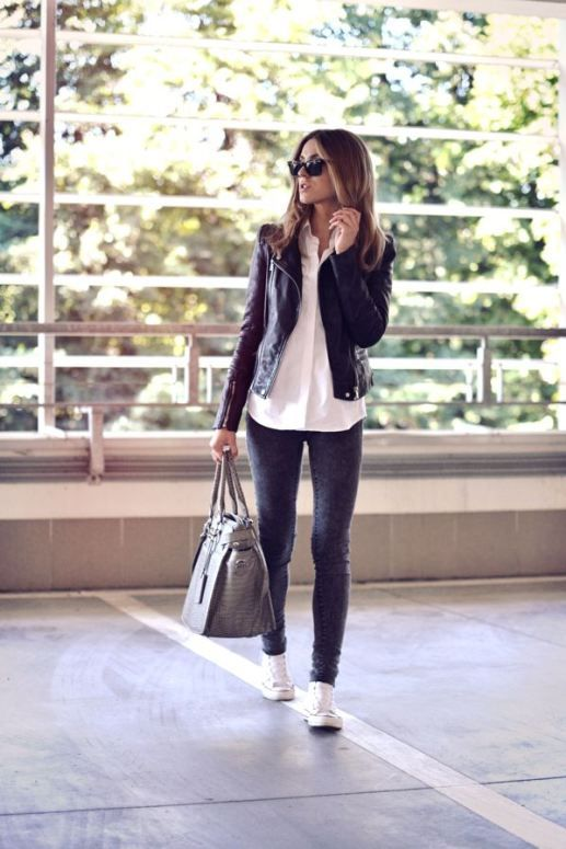 grey jeans, a white shirt and a black leather jacket