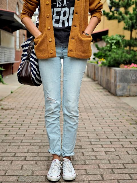 jeans, graphic T-shirt, long mustard cardigan, Converse, a striped bag