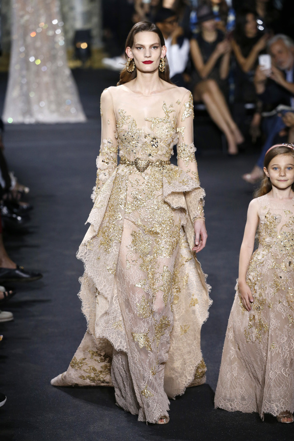 Elie Saab showed a sparkling gold wedding dress with an illusion necklines and a gold sash