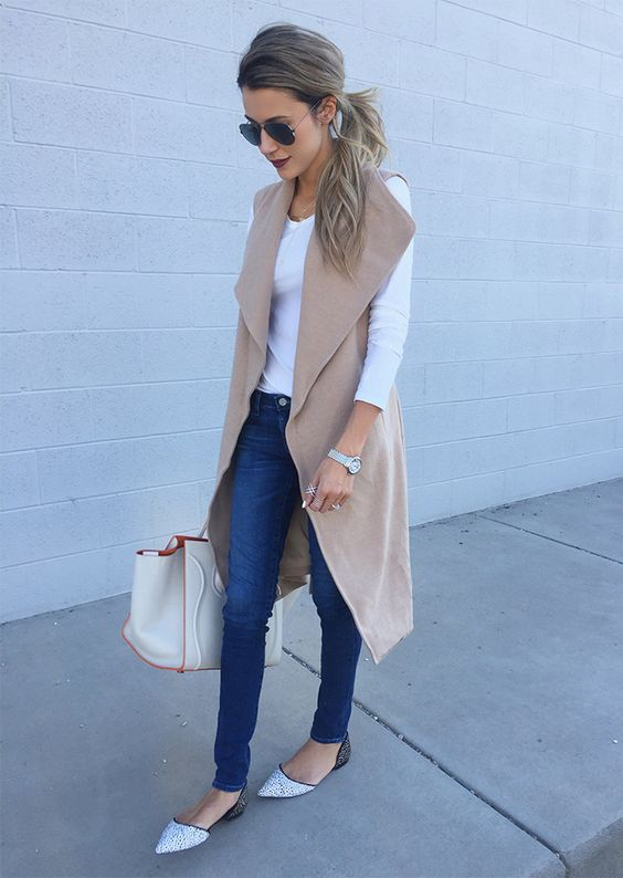sleeveless camel coat, white long tee, spotted flats and jeans