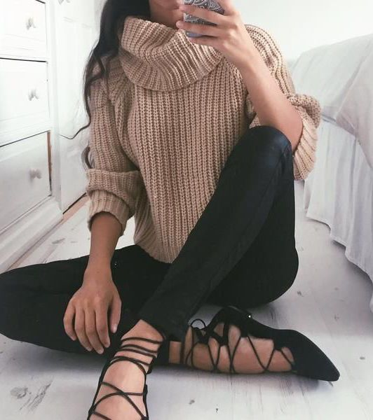 a camel turtleneck knit, black lace up flats and black leggings