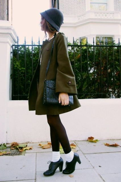 With dress, leather bag, black tights and ankle boot with white socks