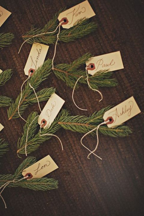 fir branches as place card holders