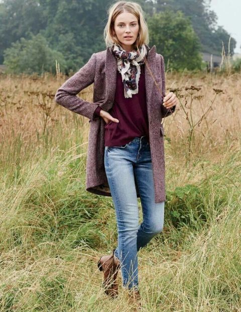 With colored shirt, jeans and brown ankle boots