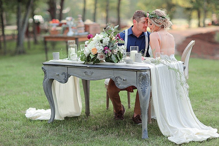 A chalk vintage table was used as a sweetheart one, it was decorated with lush flowers