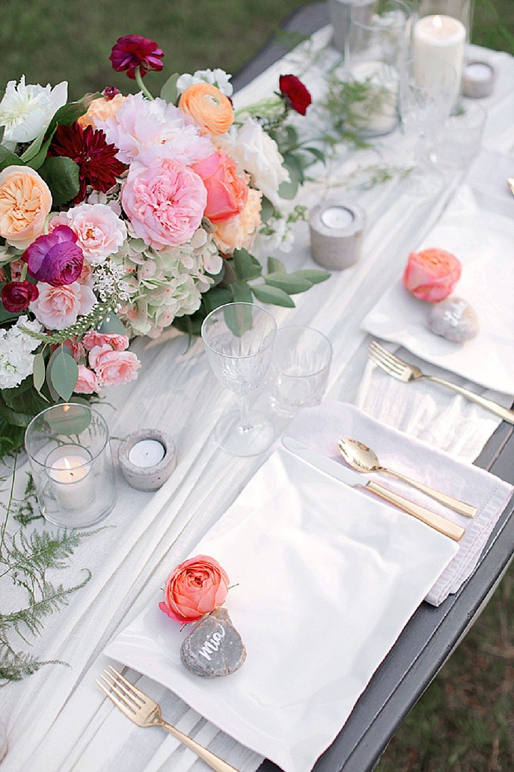 Peonies and rocks are a great idea for place cards