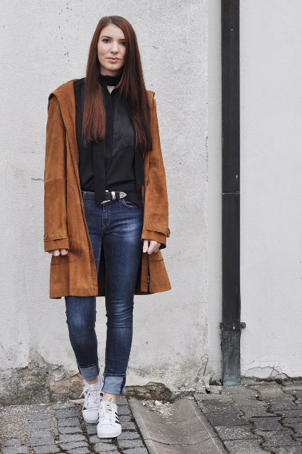 With black blouse, cuffed skinny jeans and sneakers