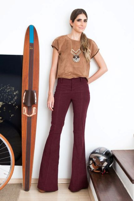 With light brown shirt and statement necklace