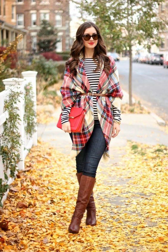 a belted plaid blanket scarf over a striped T-shirt, skinny jeans and knee high boots
