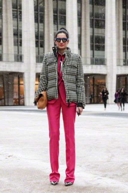 With bright pink suit, metallic shoes and leather clutch