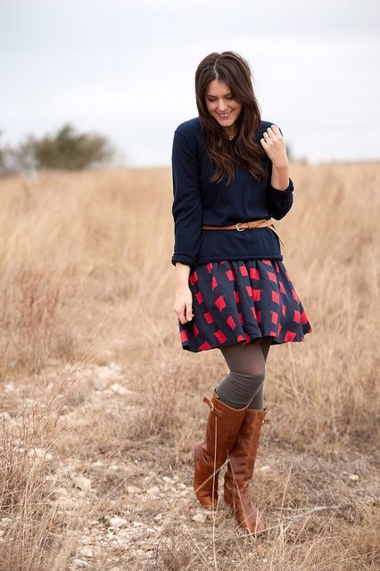 With printed skater skirt and high boots