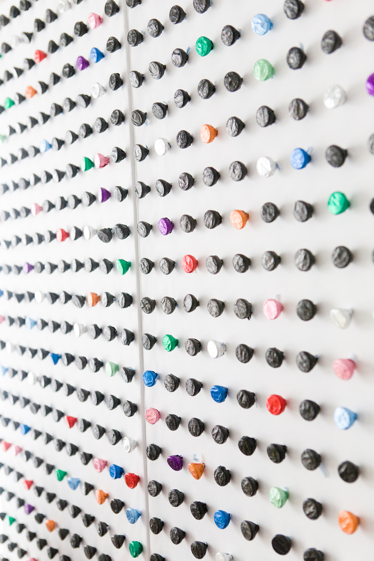 DIY Hershey Kiss Pegboard Backdrop - http://ruffledblog.com/diy-hershey-kiss-dotted-backdrop/