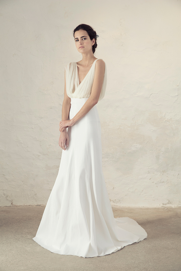 White wedding dress with a tulee top and a plain satin skirt