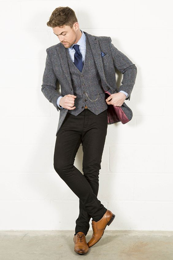black pants and a classic tweed vest and jacket