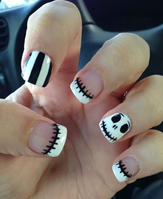 stitched French nails with stripes and jack-o-lantern accents