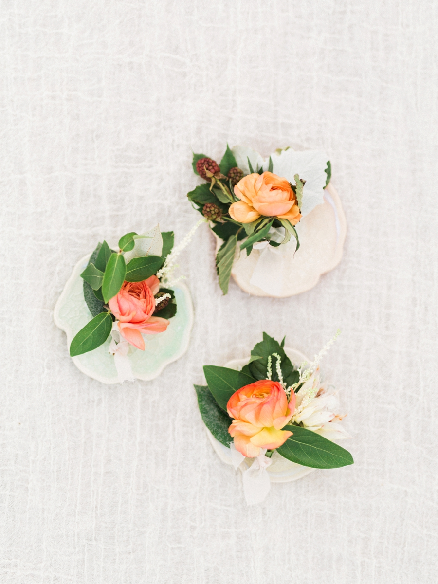 peach boutonnieres - http://ruffledblog.com/watercolor-greenhouse-wedding-inspiration