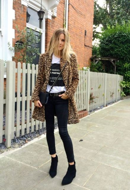 With slogan shirt, crop black pants and flat ankle boots
