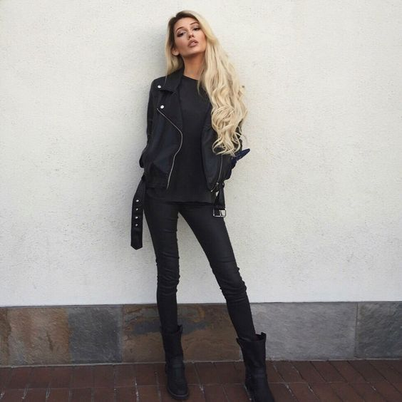 rock look with leather pants, a sweatshirt, high boots and a jacket