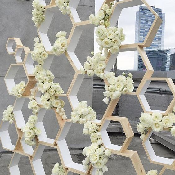 refined white honey comb backdrop with flowers