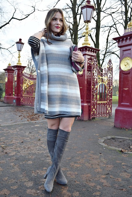 With striped dress and sweater