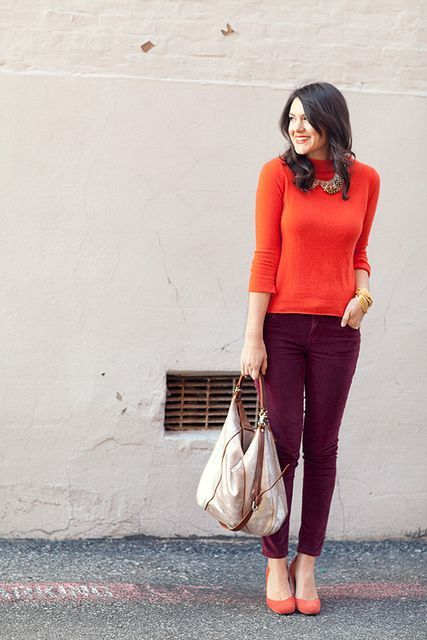 With orange shirt, statement necklace and tote